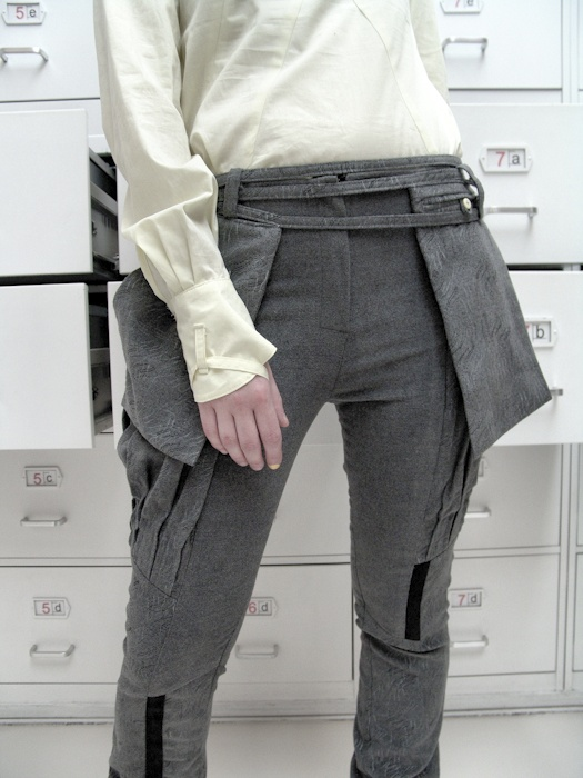 Detail: trousers ( wool, silk-screen print), belt (wool, silk-screen print)