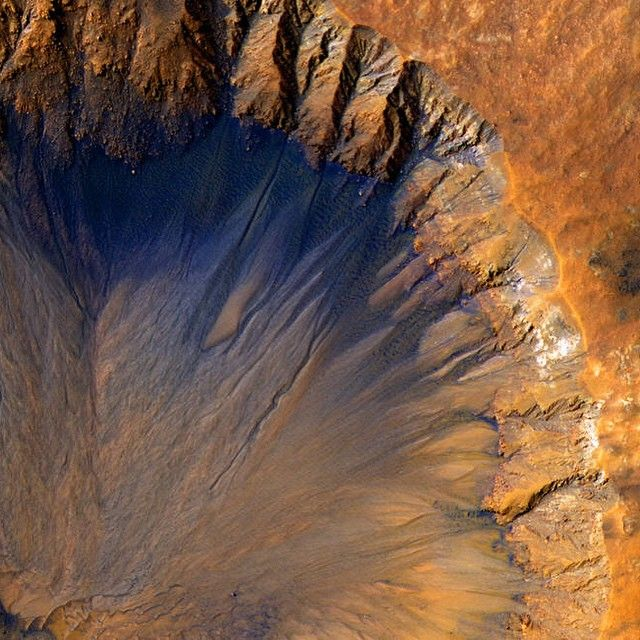 """Fresh Martian Crater: The High Resolution Imaging Science Experiment (HiRISE) camera aboard our Mars Reconnaissance Orbiter acquired this closeup image of a """"fresh"""" (on a geological scale, though quite old on a human scale) impact crater in the Sirenum Fossae region of Mars on March 30, 2015."""