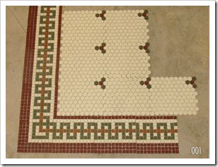 image of penny tile floor with border tile in the center and a modified square