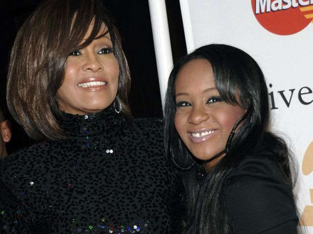 Bobbi Kristina Brown 'alive and breathing'   4 days ago