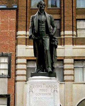 Detroit, Michigan: Statue and Tomb of the Boy Governor - The remains of Stevens T. Mason, Michigan governor at age 22, have been buried and re-buried several times, and are now in the jacked-up base of his downtown statue.