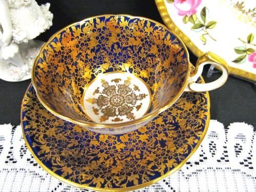 AYNSLEY TEA CUP AND SAUCER COBALT BLUE & GOLD GILT CHINTZ PATTERN TEACUP