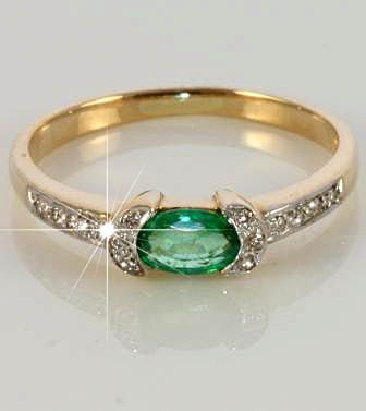 https://www.bkgjewelry.com/sapphire-ring/317-18k-yellow-gold-diamond-blue-sapphire-ring.html Emerald engagement stone: check. Yellow gold band: check. My birthstone, diamonds, encrusted next to my emerald: BONUS! This may just be the one.
