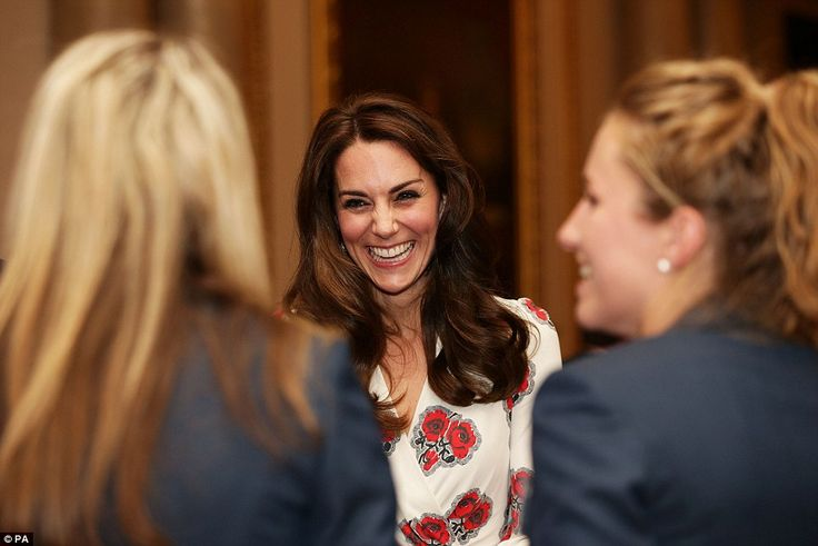 Kate broke into a fit of giggles as she spoke to the Team GB women's hockey team at the Buckingham Palace reception today