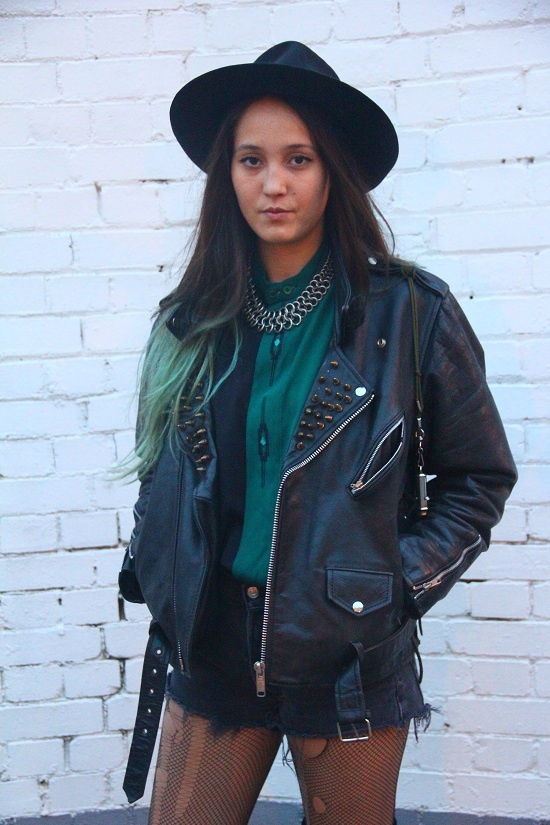 Keala from Rokit Brick Lane wears a leather jacket she studded herself and a Rokit Fedora