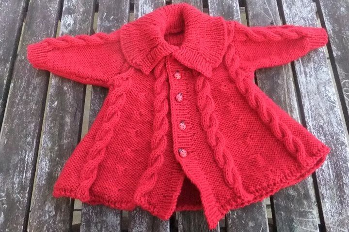 Cable design coat, designed by Karen Ashton-Mills, to fit 0-3months. Further details on www.facebook.com/Lochielknits