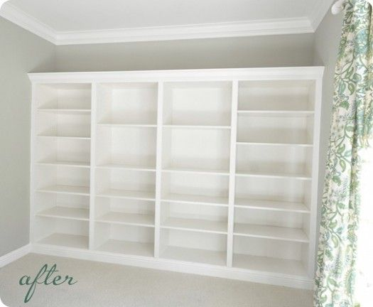 These amazing built-ins are faked with bookcases from Ikea, baseboard, and crown molding.