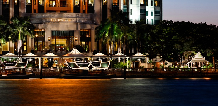 The Peninsula, Bangkok.  I have whiled away many an hour reading a book under a canopy on the grounds of this gorgeous hotel. Directly across the Chao Praya are the Oriental Hotel and the Shangri La.