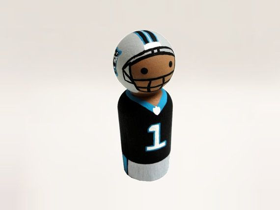 Request your own custom football player doll! The doll featured in the pictures is Cam Newton from the Carolina Panthers, but you can request any player and team youd like. These dolls are 2.5 inches tall. **If not specified, you will receive the Cam Newton doll pictured.**