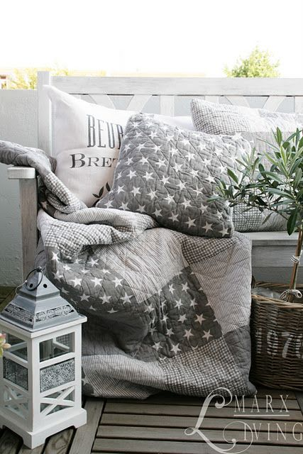 Pretty quilt and cushion in shades of grey