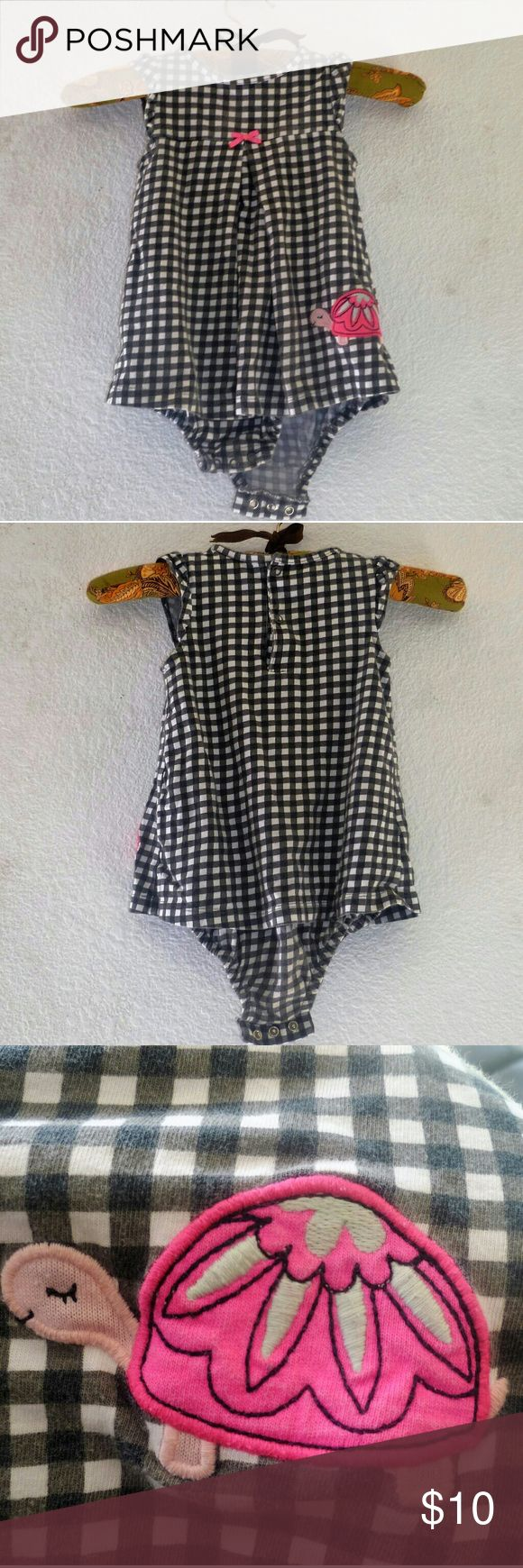Checkered pattern One piece bodysuit 24m Checkered pattern One piece bodysuit 24m. Great condition no damages. One Pieces Bodysuits