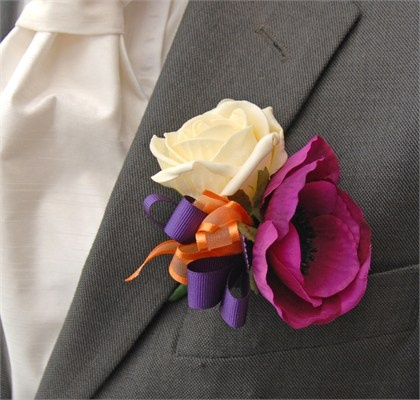 Grooms Cerise Anemone white rose wedding flower boutonniere, groom boutonniere, groom flowers, add pic source on comment and we will update it. www.myfloweraffair.com can create this beautiful wedding flower look.