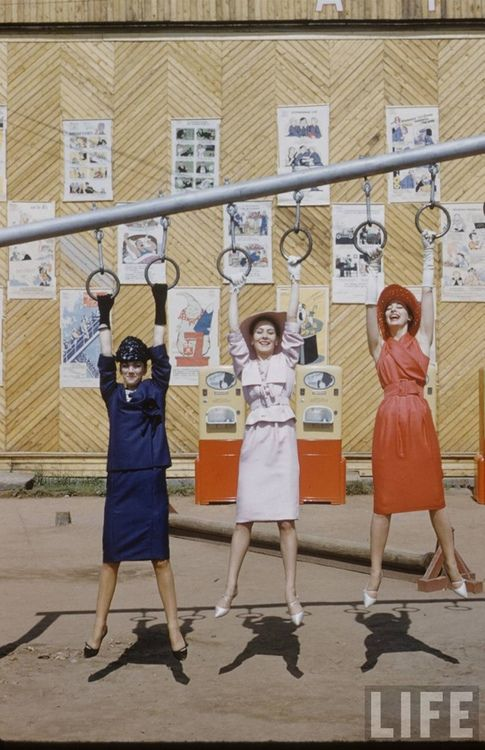 Models wearing Christian Dior photographed in a Soviet playground in Moscow, 1950s.