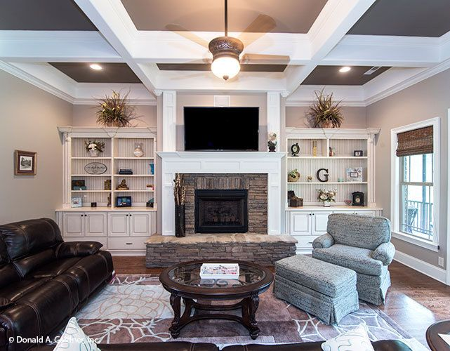 on ranch house plan with family and living room
