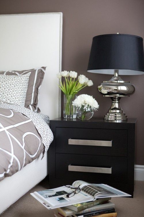 Clean lines and rich dark taupe walls with black-brown wood furniture. The silver tones add a nice offset.