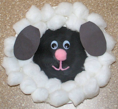 I made something similar, but sprayed cotton balls with green food coloring mixture- craft activity to go with 'where is the green sheep?' book. Cute!