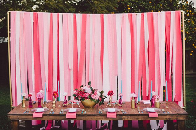 Wedding Backdrop Inspiration. A simple blast of color for any focal point. Made from PVC pipe and either fabric strips or tissue streamers. Easy to set up and can be made for less than $100.