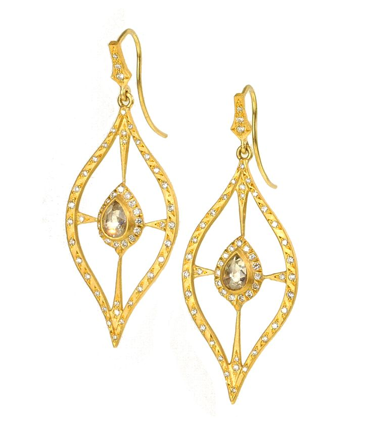 These sinuous leaf shaped earrings are centered with rose-cut diamonds…
