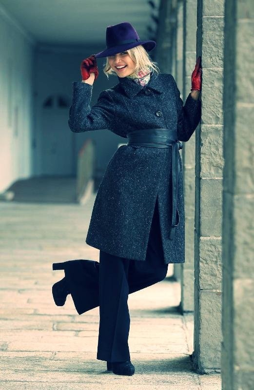 Teodora Sutra wearing a Samir tweed grey and black wool coat (€350) by Jimmy Hourihan, purple wool felted Trilby (€180) by Wendy Louise Knight and silk scarf (€75) by Lisa Ryder