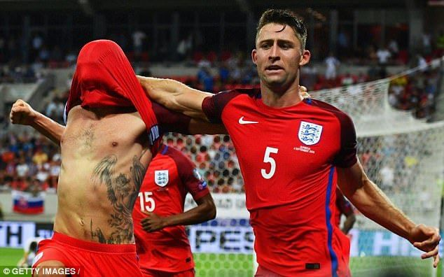 Adam Lallana (left) and Gary Cahill celebrate after the former's late winner against Slovakia