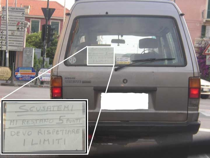 In Italy the license is in points, it start with 20 points but if you commit infractions such as exceeding the speed limit, in addition to the fine, some points are removed from your license. Once you run out of points, you have to go back to the driving school and pass an exam. The driver of the car on that picture has only 5 points left on his license. For many Italians driving slow  is not nice, that's why this driver feels obliged to apologize to the cars behind him!