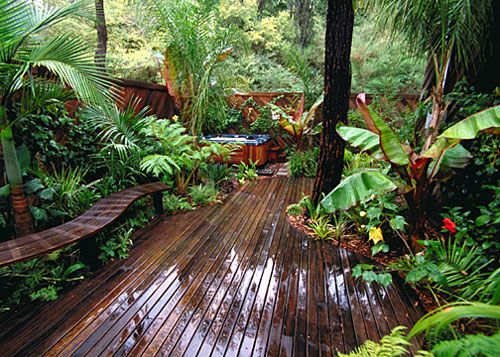 Gorgeous deck and seating... love the lush landscape