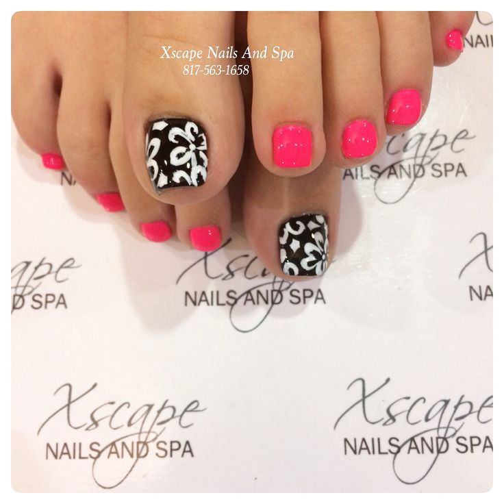 Pretty pedicure: black polish with white flower design. Bright/ Fluorescent Punk polish on all of the small toes. I love this!