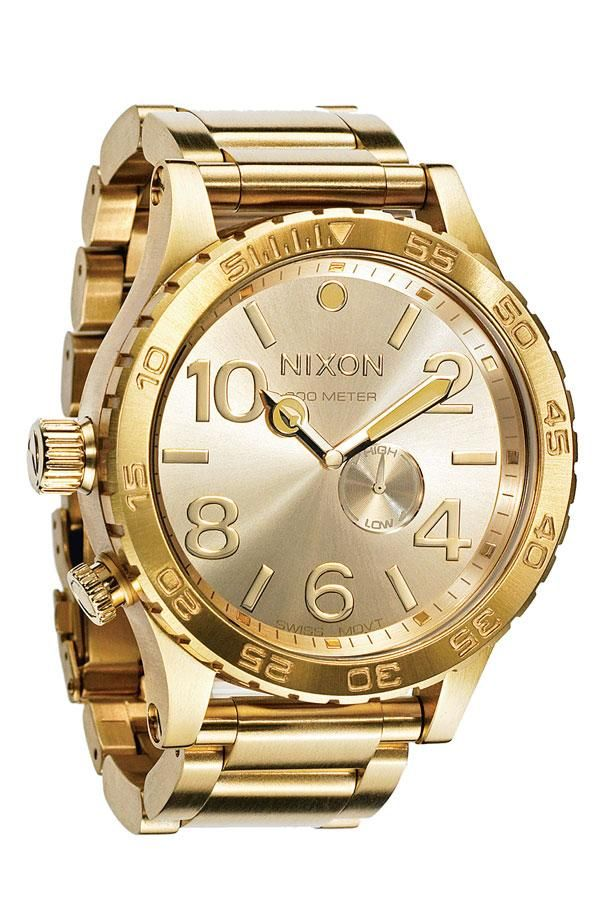 17 best images about men watches skeleton watches this shiny gold nixon watch is perfect for father s