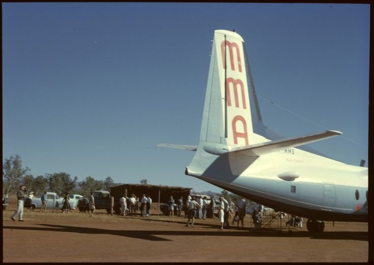 146168PD: The terminal at Kununurra Airport, 1962. MMA crew and passengers wait to board VH-MMS.  http://encore.slwa.wa.gov.au/iii/encore/record/C__Rb4234139__Smacrobertson%20miller__P4%2C113__Orightresult__U__X3?lang=eng&suite=def