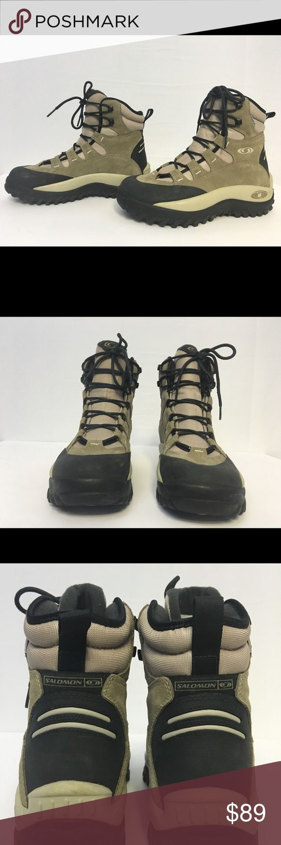 Salomon Hiking Boots Never worn, Salomon Hiking Boots with Contagrip technology for optimal grip.  Note:  Boots never worn, one scuff as shown in pic #7 Salomon Shoes