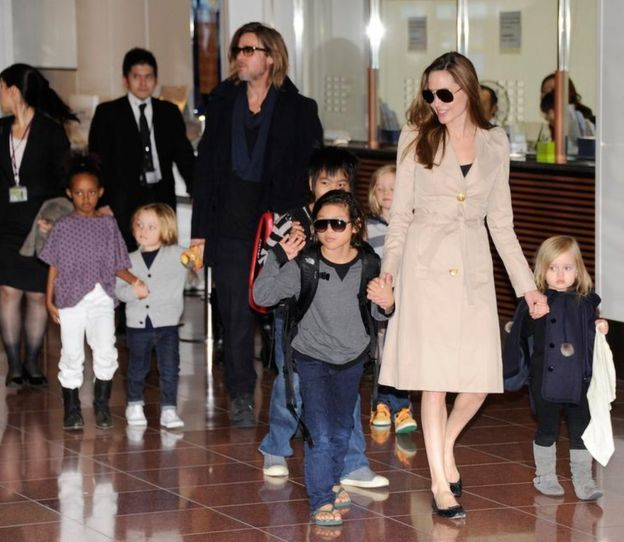 Pictured with their children, US movie stars Brad Pitt and Angellina Jolie arrive at Haneda Airport in Tokyo on November 8, 2011.