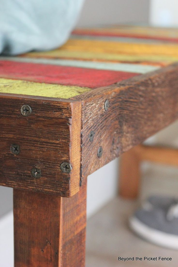 Colorful rustic bench made with pallet wood and reclaimed wood