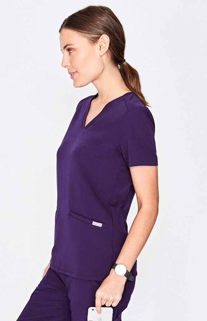 dcf7a728dca With stretch fabric and three pockets, the women's Casma scrub top is ready  for busy days. Part of FIGS' Technical collection of tailored-fit scrubs.