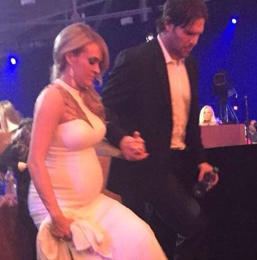 Pregnant Carrie Underwood and her husband Mike Fisher at the ACCAwards