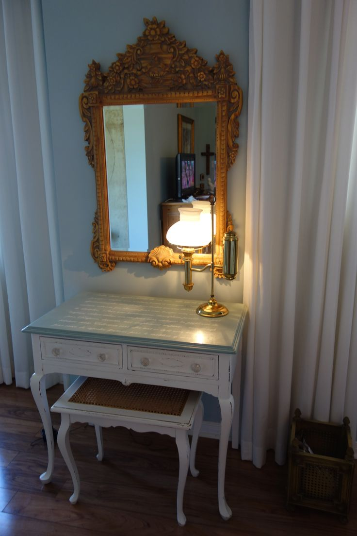 dressing table with french letter on top