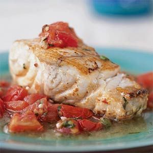 The grouper is seared to give it a slightly crisp crust that can hold up to the moisture from the tomato topping. Use a heavy oven-proof skillet that can go from stovetop to oven. To seed a tomato, cut it in half, hold each half in the palm of your hand, and squeeze gently.