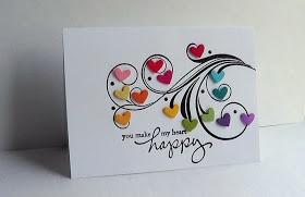 a rainbow of hearts on a flourish