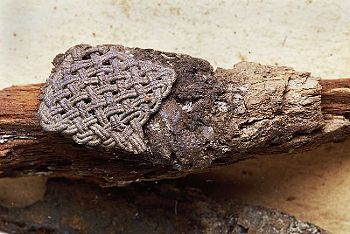 Textile (and silver posament) fragment from Birkas' Homelands, grave 832.