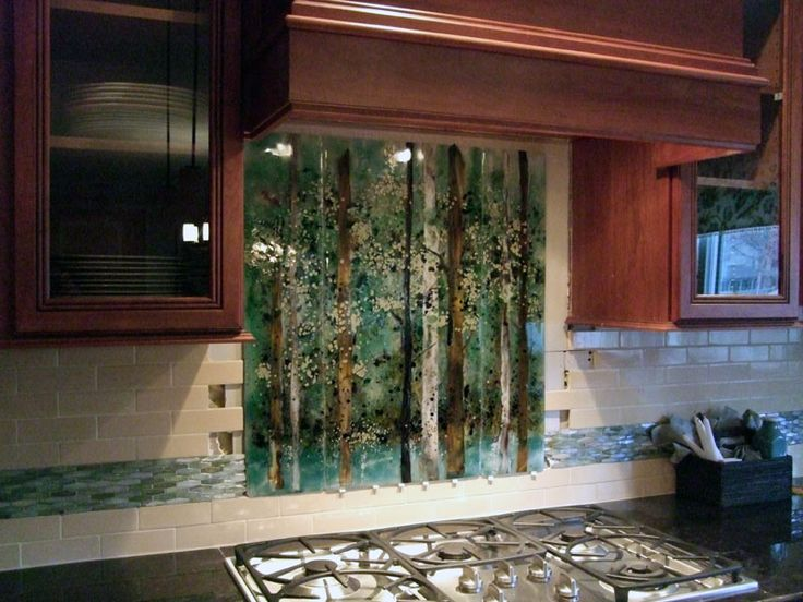 We created this custom fused glass backsplash for our client in Cornelius,  North Carolina featuring native birch trees. It is comprised of three fused  glass ...