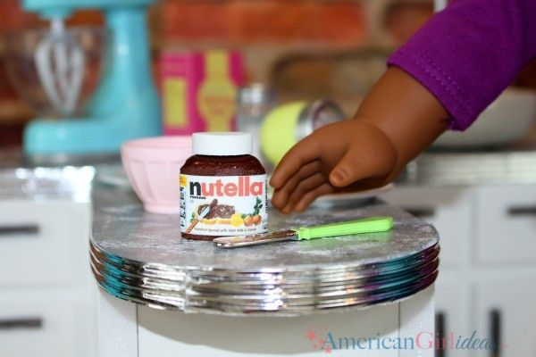 American Girl Doll DIY Nutella Craft Slowly but surely we are adding things to our DIY Gourmet Kitchen! We need those cabinets full! This Nutella craft is easy and you can put it in your dolls kitchen or in your grocery store. Thanks to everyone who requested this! Materials Needed: nutella label printable Glue stick …