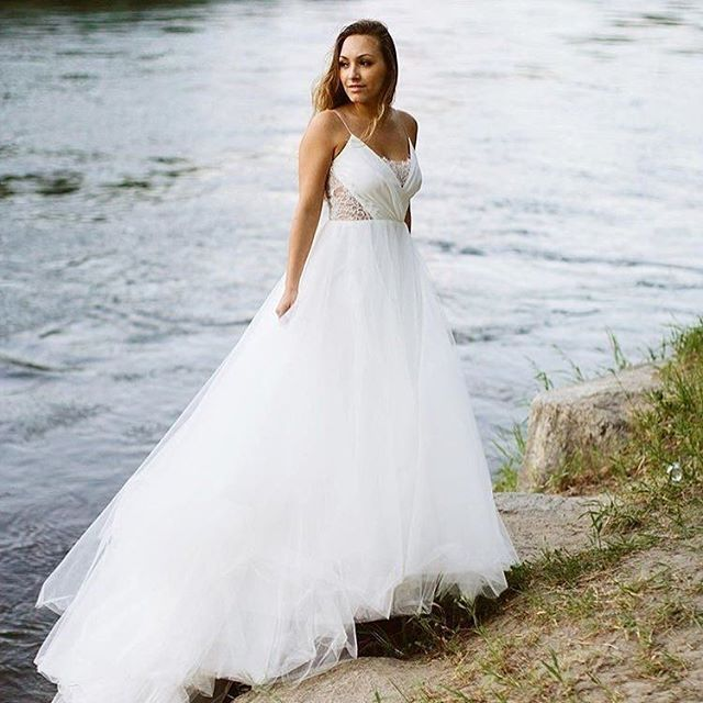 Simple Christos wedding dress with lace cutouts and full skirt from Emma u Grace Bridal Studio