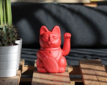 "Lucky Cat ""Gatete"" Is the stylish version of the classic lucky cat handpainted in light red colour 10.5x9.5x17.5 cm"