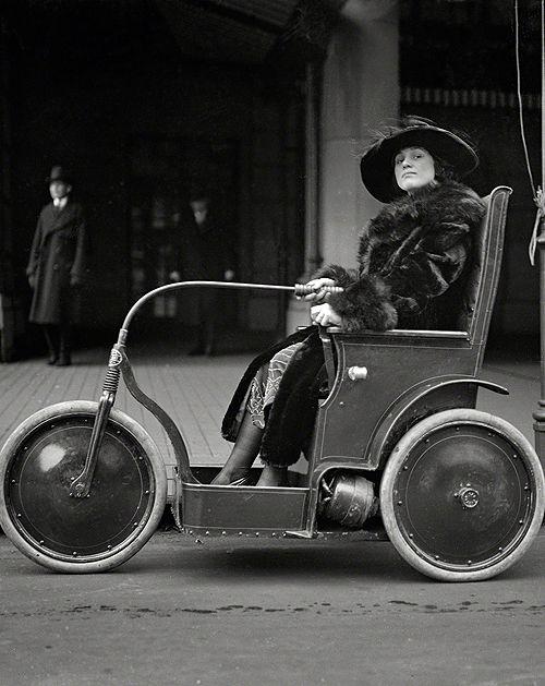 January 22, 1922. Washington, D.C. Woman in a three-wheeled vehicle.