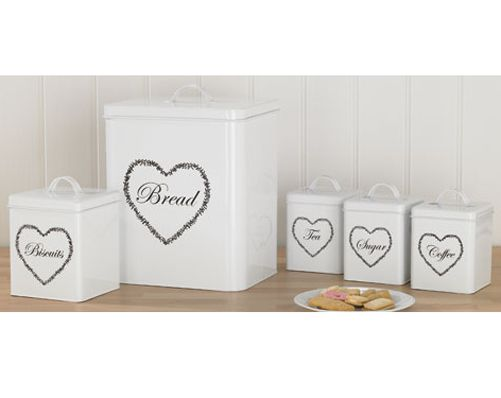 Hearts 5-Piece Storage Set £20.00 5-piece enamel storage set with a cross stitch hearts design. Contains tea, coffee and sugar canisters H14 x W11 x D11cm, biscuit tin H19 x W14 x D14cm, bread bin H30 x W26 x D21cm.