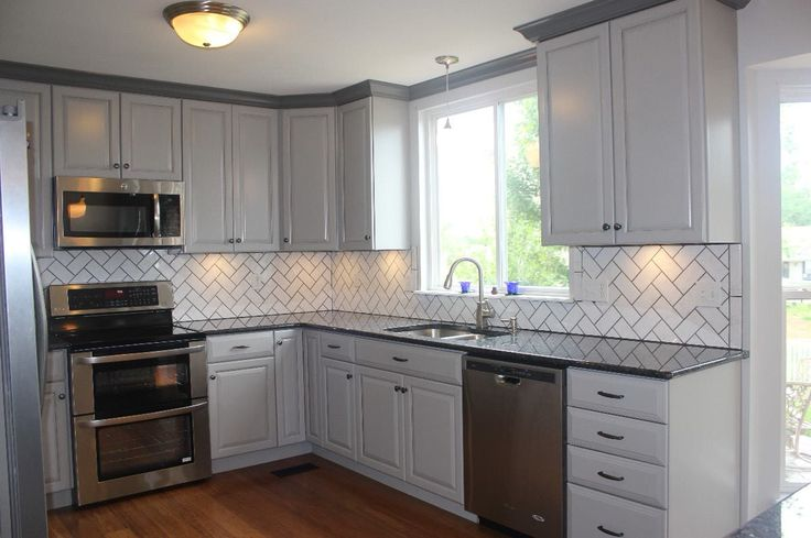 Gray cabinets and blue pearl granite