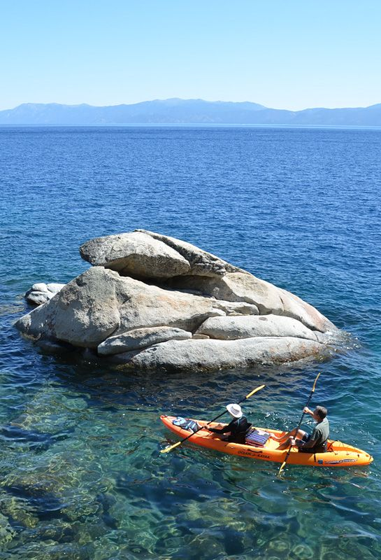 Kayaking along Lake Tahoe's west shore near DL Bliss State Park. The perfect Lake Tahoe summer escape.