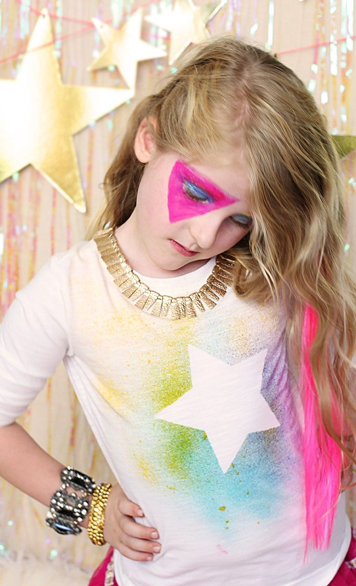Rock Star T-shirts are a cinch to make with this quick DIY: Find spray dyes, and your favorite stencil shapes, then spray over the stencil. We decided to dress up just like rock stars from Jem and the Holograms in their new movie.