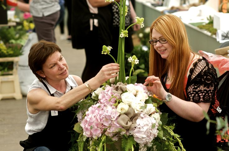 Our very talented Floristry students putting the finishing touches on site