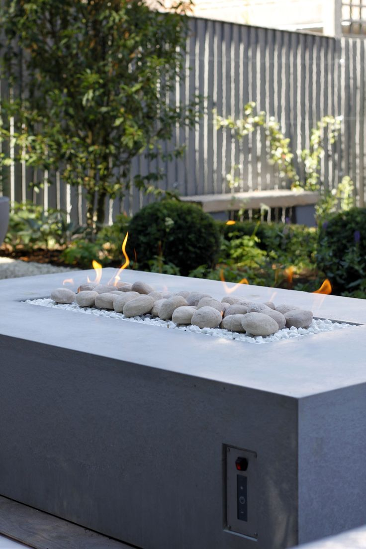 Chic modern garden design in chelsea by declan buckley with steps and - Outdoor Burner With Contemporary Pebble Design