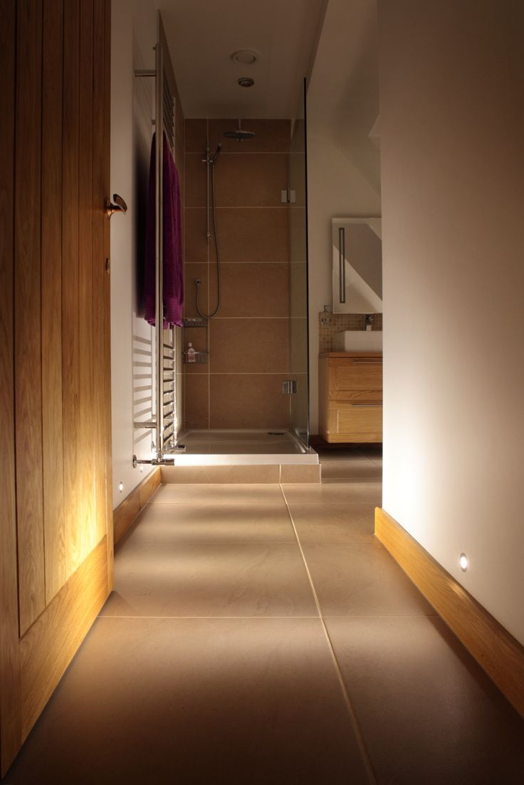 Mini wall recessed lights guide guests into this guest ensuite whilst providing background and night lighting